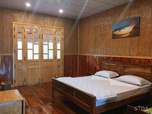 A bed or beds in a room at MEKONG NATURE LODGE