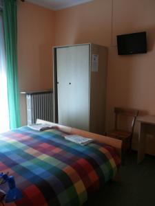 Letto o letti in una camera di Albergo Il Gembro