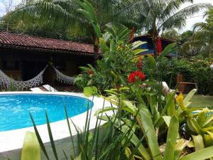 The swimming pool at or near Pousada Vila Mato Verde