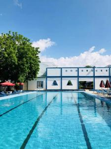 The swimming pool at or near Hotel Chez Wou