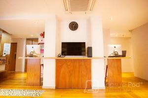 The lobby or reception area at Capsule Pod Boutique Hostel