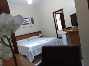 Uma cama ou camas num quarto em Pousada Cavaleiros