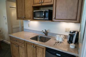 A kitchen or kitchenette at The Cove at Yarmouth, a VRI resort