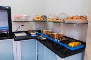 A kitchen or kitchenette at Hotel Naturalis Eireli