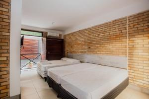 Cama ou camas em um quarto em Economy Flat