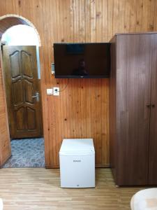 Телевизор и/или развлекательный центр в Hotel Old Star