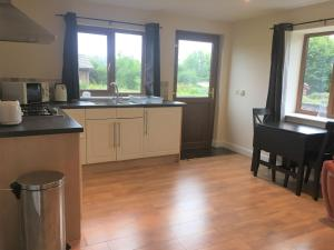 A kitchen or kitchenette at Poplars 1 - One bed apartment on private estate