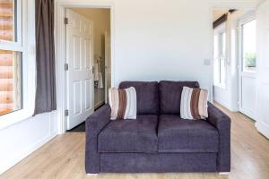 A seating area at Rowan 1 - Standard Plus One Bed Apartment On Private Estate