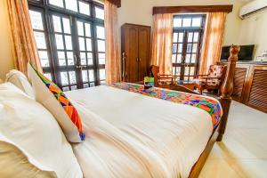 A bed or beds in a room at Sunset Beach Resort