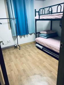 A bunk bed or bunk beds in a room at Bomulzip Hongdae guesthouse