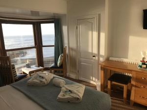 A bed or beds in a room at Cardigan Bay Guest House