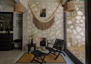 En sittgrupp på Coqui Coqui Papholchac Coba Residence & Spa