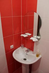 Ванная комната в Отель и хостел Люкс на Городском