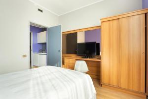 TV o dispositivi per l'intrattenimento presso Nizza26 Serviced Apartments