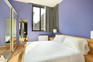 Letto o letti in una camera di Nizza26 Serviced Apartments