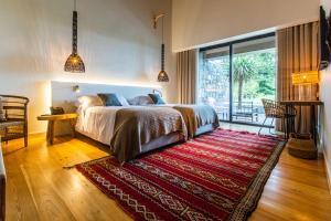 Uma cama ou camas num quarto em SENSI Azores Nature and SPA