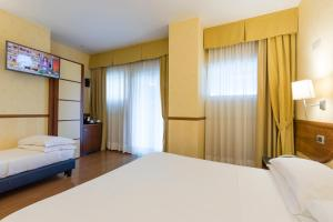 A bed or beds in a room at Best Western Hotel I Colli
