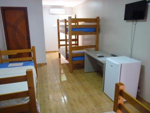 A bunk bed or bunk beds in a room at Hostelplan