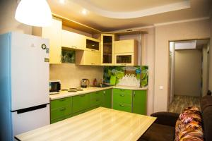Кухня или мини-кухня в Аpartment Millennium
