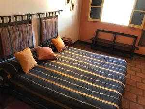 A bed or beds in a room at La Vaca Tranquila