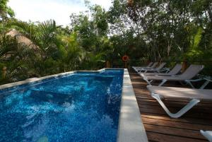 The swimming pool at or near Joy Tulum - Adults Only.
