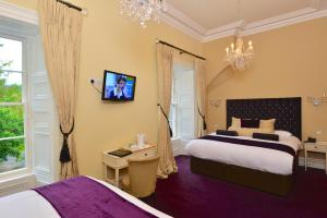 A bed or beds in a room at Belleek Castle