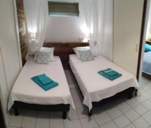 Un ou plusieurs lits dans un hébergement de l'établissement Villa Kannel