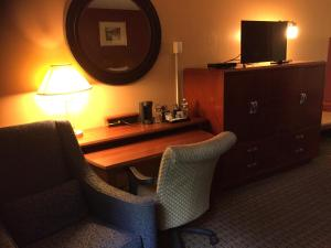 A television and/or entertainment center at Arbor Inn - Weymouth