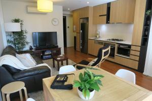 A television and/or entertainment center at South Yarra Gem - 2bed, 2bath, Carpark, Wifi