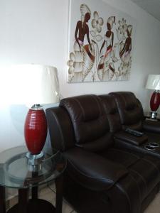 A seating area at Luxury apartment near isla verde beach