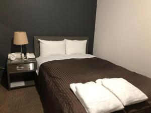 Hotel New White House 객실 침대