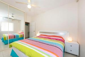 A bed or beds in a room at Debra Court Unit 1