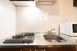 A kitchen or kitchenette at OYO Hotel MUSUBI KYOTO Shimabaraguchi