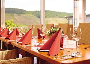 A restaurant or other place to eat at WeinBergHotel Nalbach