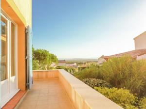 A balcony or terrace at Modern Villa in Saumane-de-Vaucluse with Swimming Pool