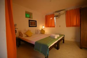 Un ou plusieurs lits dans un hébergement de l'établissement La Closerie - Bay of Bengal