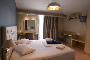 Un ou plusieurs lits dans un hébergement de l'établissement Viaros Hotel Apartments