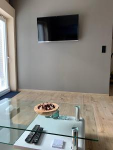 Televízia a/alebo spoločenská miestnosť v ubytovaní Grand Spa Holiday Home II