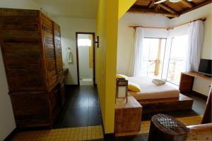 Cama ou camas em um quarto em Pousada Arágua