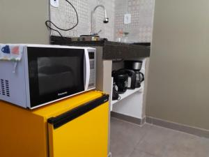 A television and/or entertainment centre at Flat Container Pontal do Atalaia