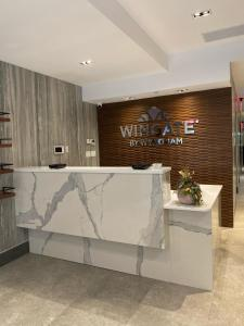 The lobby or reception area at Wingate by Wyndham New York Midtown South/5th Ave