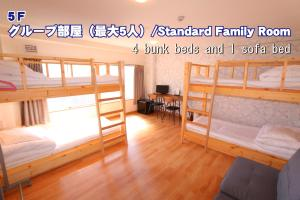 A bunk bed or bunk beds in a room at RED HELMET House & Sports Bar Hiroshima