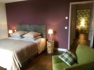 Кровать или кровати в номере Clos Des Aspres