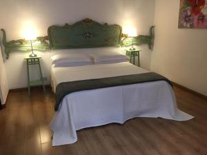 A bed or beds in a room at Ascanio Twenty Six