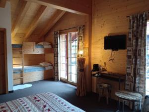 Un ou plusieurs lits dans un hébergement de l'établissement Hotel L'Etable