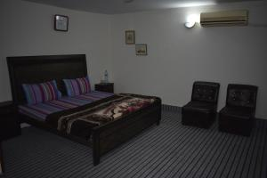 A bed or beds in a room at Green Residence