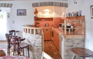 A kitchen or kitchenette at Nice apartment in Zsámbék w/ 2 Bedrooms