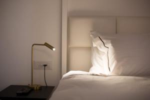 מיטה או מיטות בחדר ב-וילה גליליי מלון בוטיק וספא