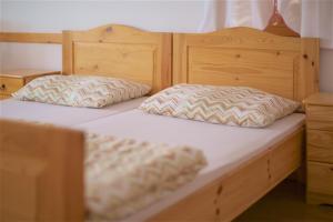 A bed or beds in a room at Turistična kmetija Lovrec