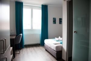 Ein Bett oder Betten in einem Zimmer der Unterkunft Hotel im Kaiserpark